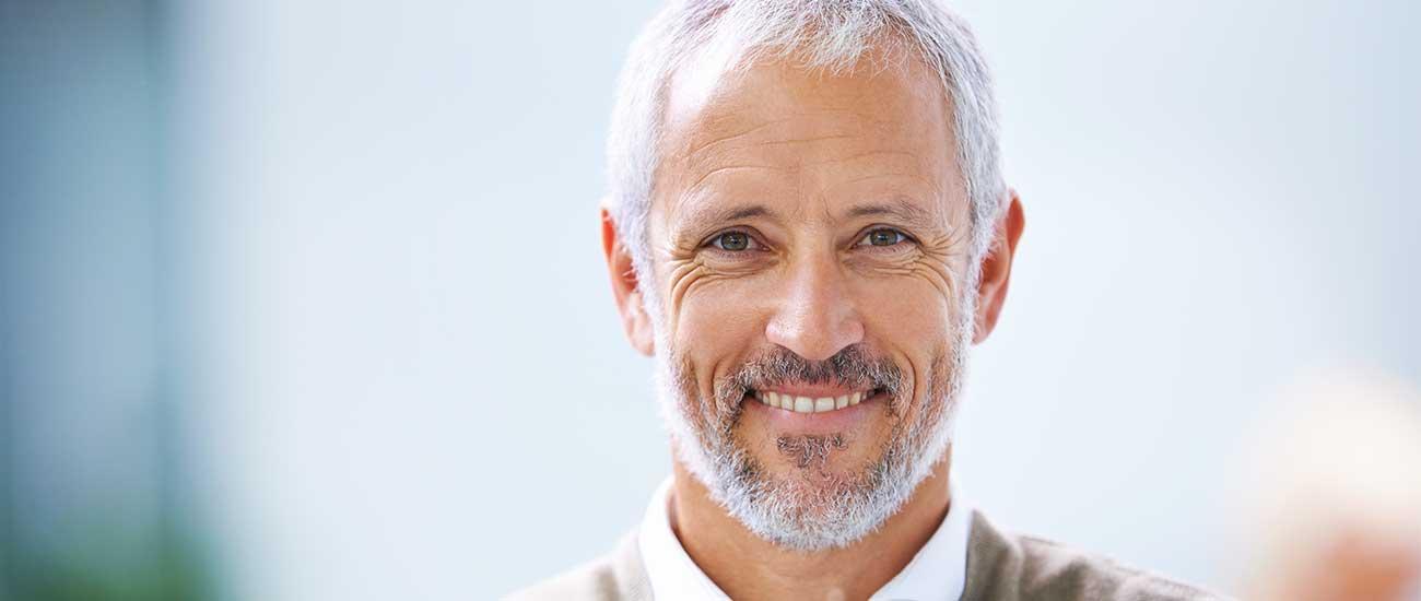 elder business man smiling naturally at camera personal brand